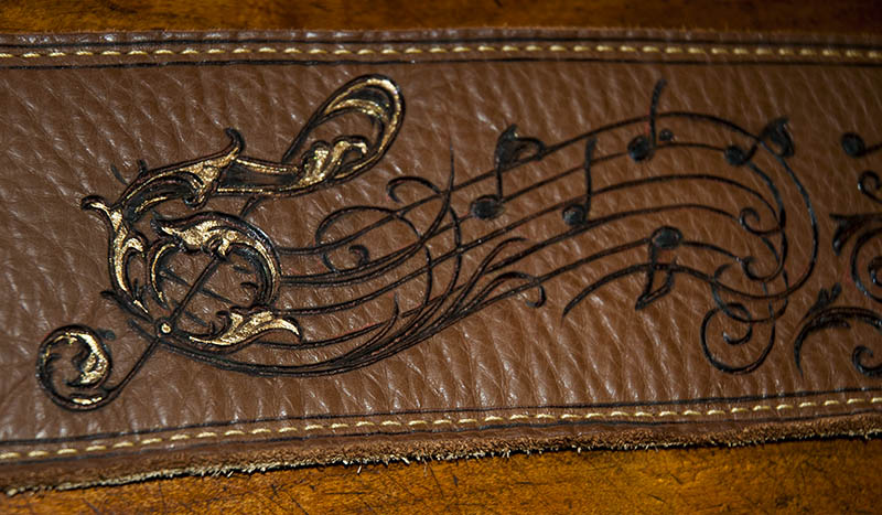 burnmethod, guitar, strap, pyrography, custom, wood burning, engraved, personalized, leather, vintage, brown, intricate, ornate, scrollwork, treble, clef, music, notes, victorian